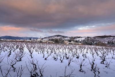 Village of Denice and landscape of Beaujolais under the snow