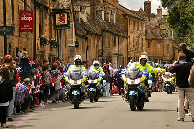Police Motorcyclist High Five Crowd at Olympic Torch Relay