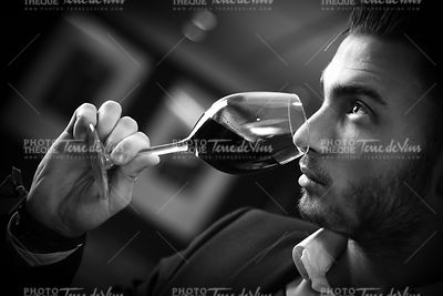 Young man with redwine glasses at celebration or party