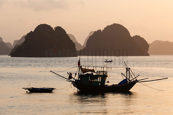 Squid Fishing Boat in Halong Bay at Dawn