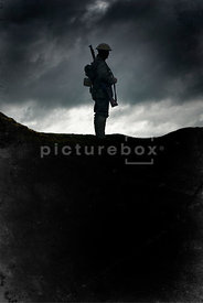 An atmospheric image of a silhouetted, lone, standing British soldier in WW1.
