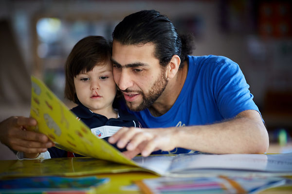 A dad and his son reading at Martenscroft Nursery
