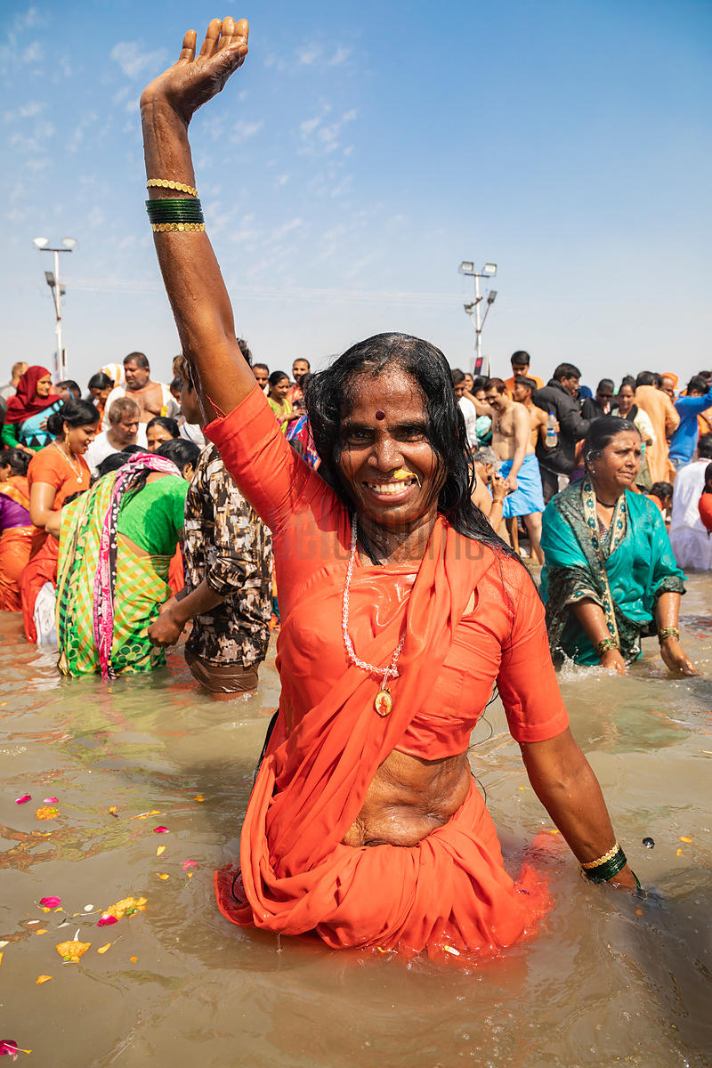 A Woman Enjoys a Dip in the Ganges at the Sangam