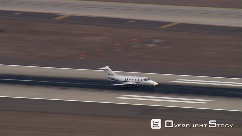 Aerial view of business jet ascending from runway
