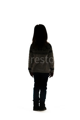 A silhouette of a little girl standing, facing away – shot from mid level.
