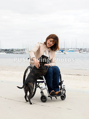 Woman using a wheelchair with her dog