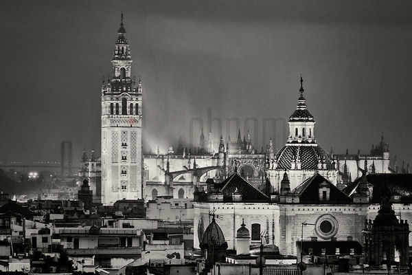 Seville Cathedral and the Giralda in the Rain at Dusk