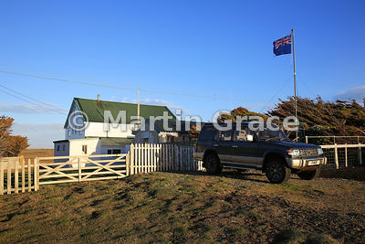 Pebble Island Lodge, Pebble Island, West Falkland, showing Falkland Islands flag and Mitsubishi 4-wheel-drive vehicle