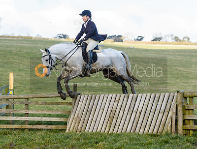 Emma Hyslop-Webb jumping a fence away from Peake's Covert