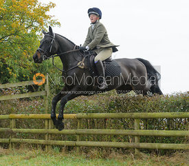 Hermione Brooksbank jumping a hedge near Wilson's - The Cottesmore at Langham.