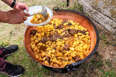 Chanfana, a traditional dish made with roasted old goat, potatoes, red wine, garlic, laurel and pepper, prepared during the R...