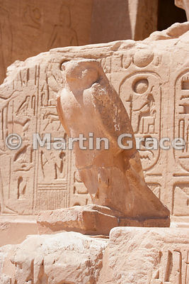 Statue of the falcon god Horus on the facade of the Sun Temple of Abu Simbel, Egypt