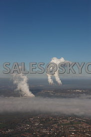 Power stations aerial photograph of the plumes of steam being vented by the Rocksavage power station in the foreground and Fi...