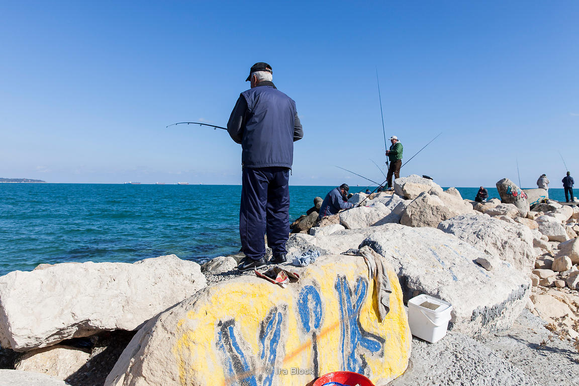 Ira Block Photography   A man fishing on the Black Sea, in