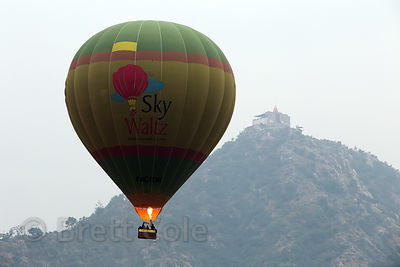 A hot air balloon passes in front of Savitri Temple during the Pushkar Camel Fair, Pushkar, Rajasthan, India