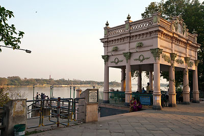 India - Chandannagar - Two women sit by the pier on the Strand by the Hoogley River