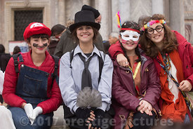 Young smiling Women posing in St Mark's Square  in fancy dress