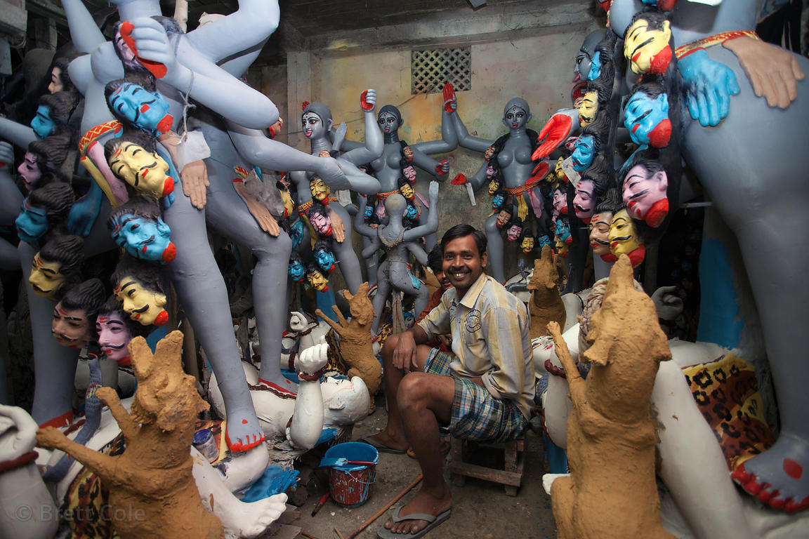 Idols being made in Kumartoli (Potter's Town) for the Kali Puja festival, Kolkata, India. They're made by hand with straw for...