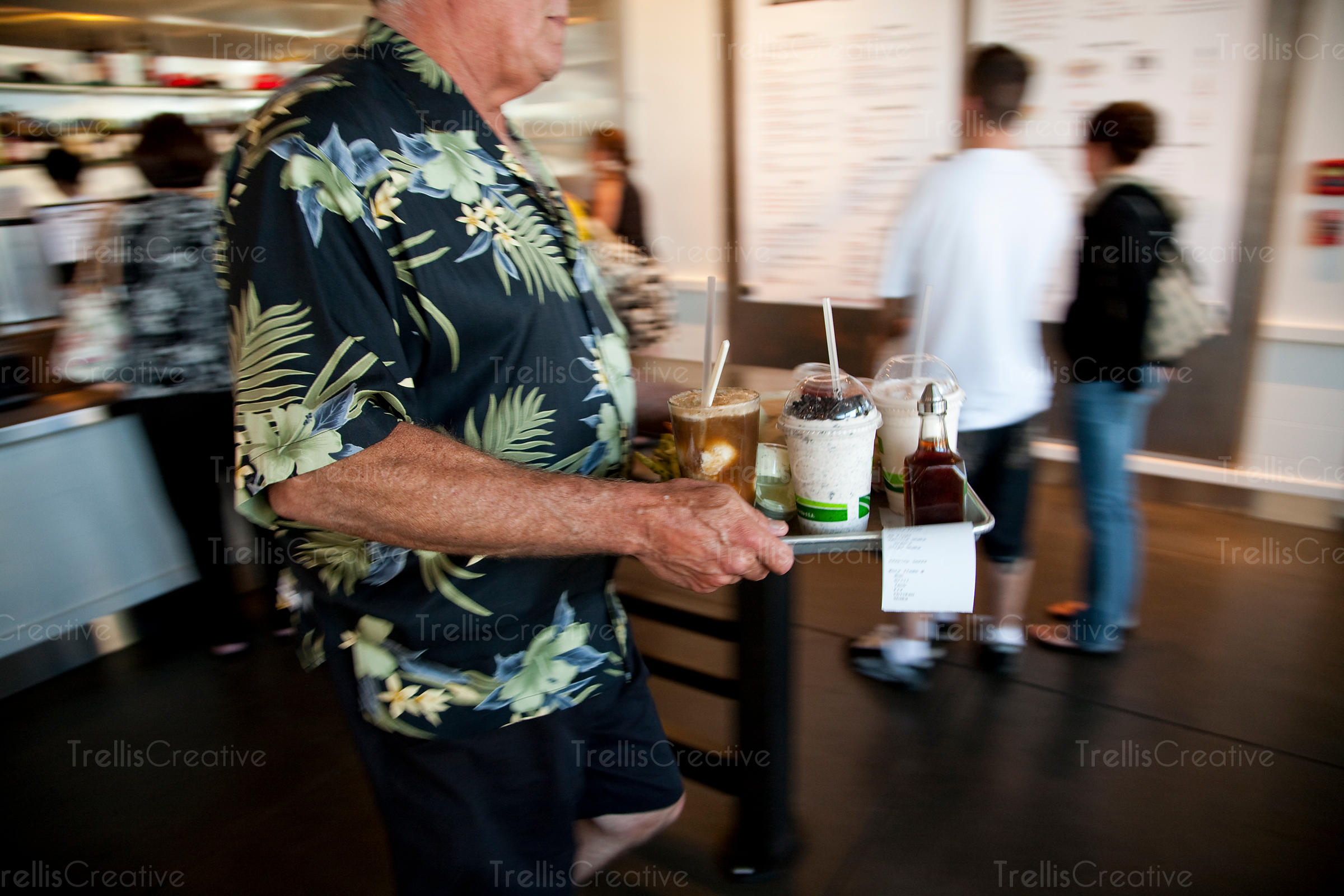 A customer carries his tray of fast food