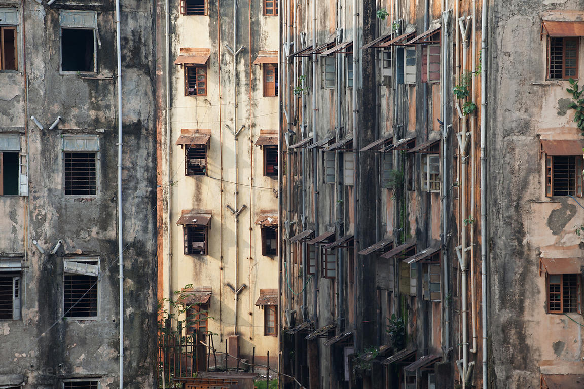 Weathered old apartment blocks in Antop Hill, Mumbai, India.