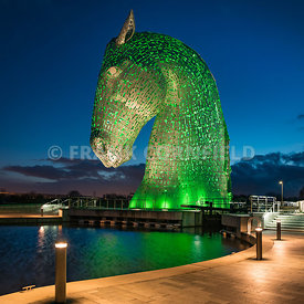 FALKIRK, SCOTLAND – MARCH 16, 2017: The head of a Kelpie horse sculpture at The Helix Park in Falkirk Scotland illuminated in...