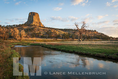 Reflection in river of Devils Tower at sunrise