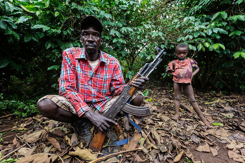 Portrait of a Cattle Herder with an AK-47