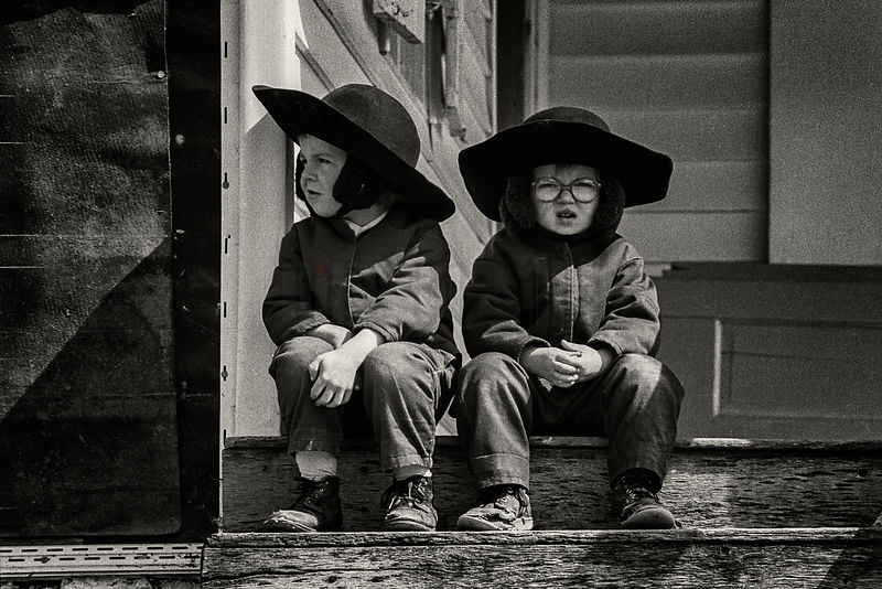 Young Amish Boys Sitting on a Step