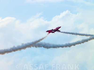 Red Arrows displaying aerobatics at Farnborough International Airshow 2014