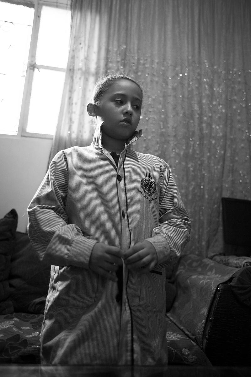 Rayan, 10 ans se prépare pour partir à l'école de l'UNRWA, camp de Chatila, Liban / Rayan is getting ready to go to the UNRWA...