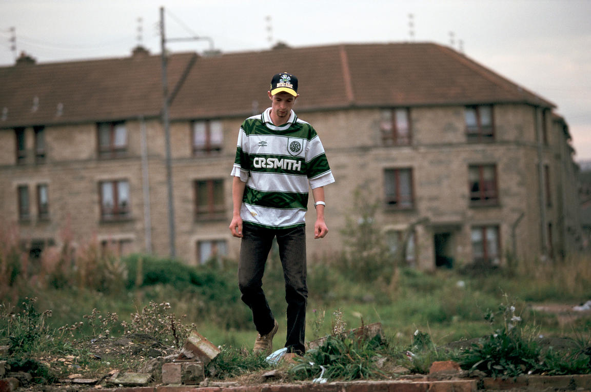 Scotland - Glasgow - A young Celtic fan walks through a housing estate