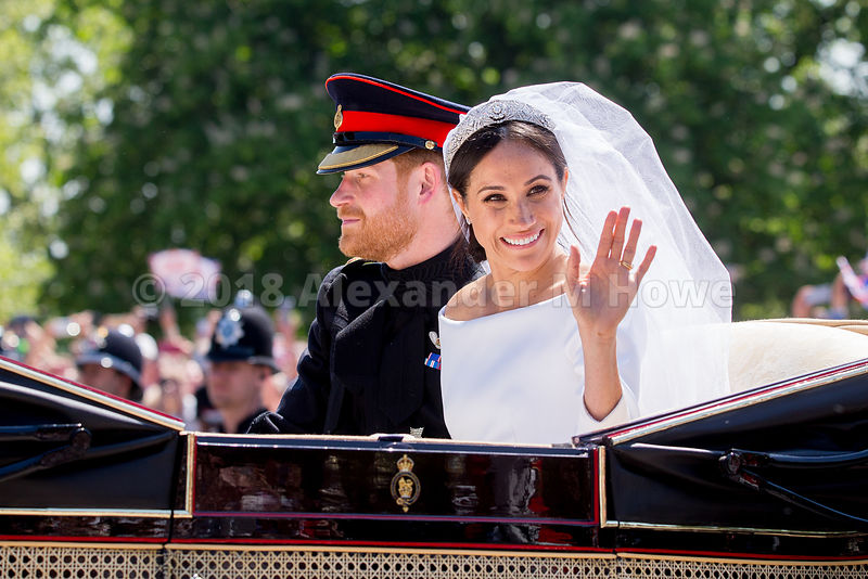 Duchess of Sussex, Meghan Markle waving to the crowd during the royal couple's carriage ride