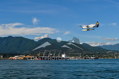 July 16, 2015. A floatplane comes in for a landing on a summer sunny day in Vancouver BC. Photo by Scott Brammer - coastphoto...