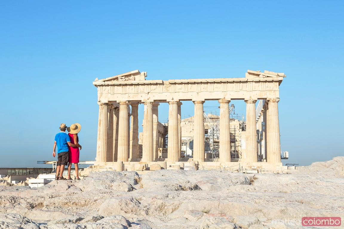 Couple  looking at Parthenon temple on the Acropolis, Athens, Greece