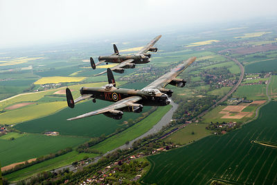 Two Lancasters over the upper Thames