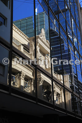 Facade of the stone building of the Central Bank of the Argentine Republic, Buenos Aires, Argentina, reflected in the glass o...