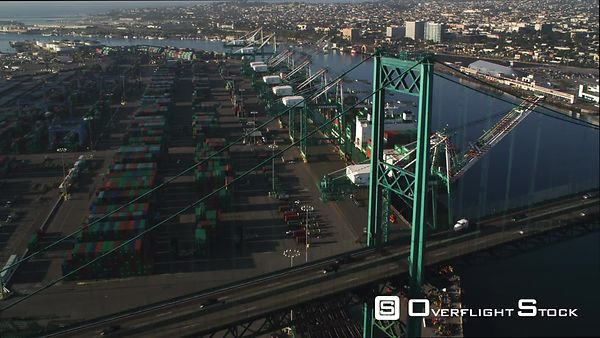 Flying Over Vincent Thomas Bridge in Los Angeles Harbor, Container Ship at Dock.