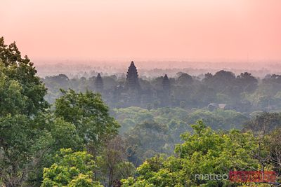 Angkor Wat temple at sunset in the middle of the jungle, Cambodia
