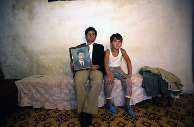 Albania - Lepurush Village - Selam Brahim with a portrait of her younger self and her nephew
