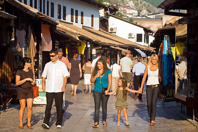 Bosnia - Sarajevo - A family walks through the market in Sarajevo