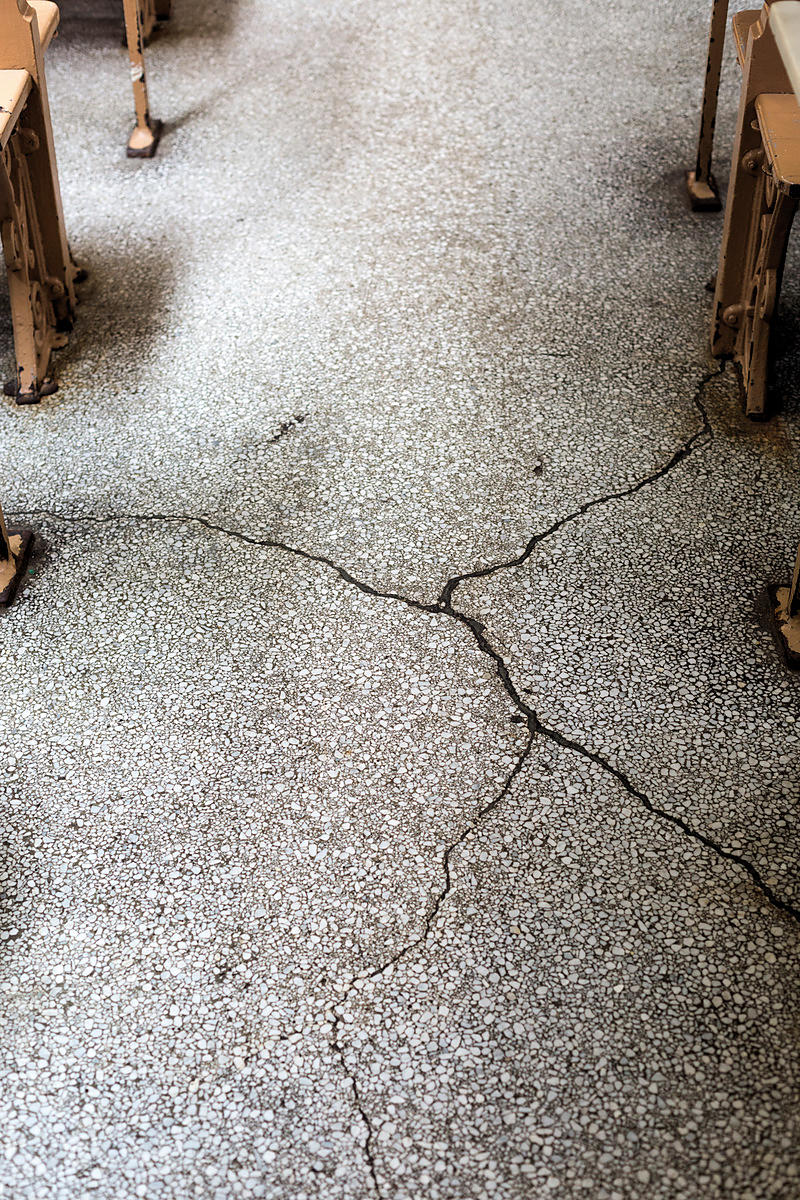 The cracked floor at Manze's Pie and Mash shop in Deptford, London