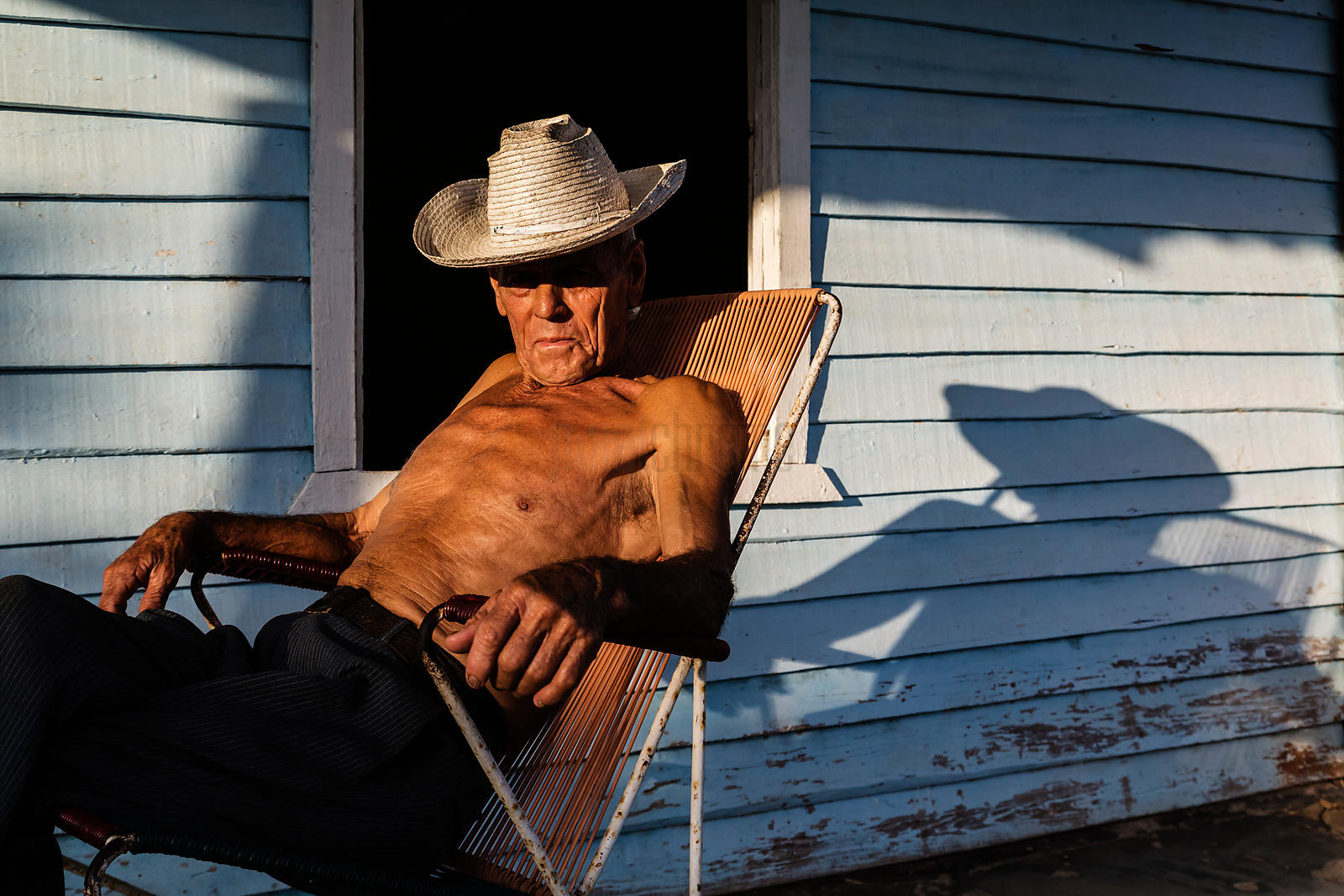 Elderly Man Sitting on Porch