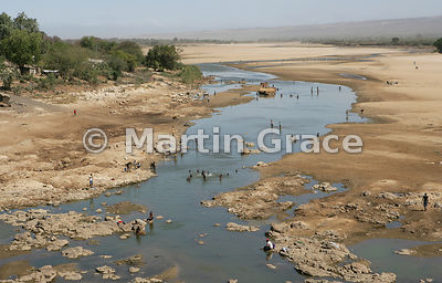 Mandrare River, Anosy Region, Madagascar with a lot of human activity, including collecting drinking water, washing, washing ...