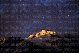 Stars above Mt Huayna Potosí and lights of climbers on the glacier, Cordillera Real, Bolivia