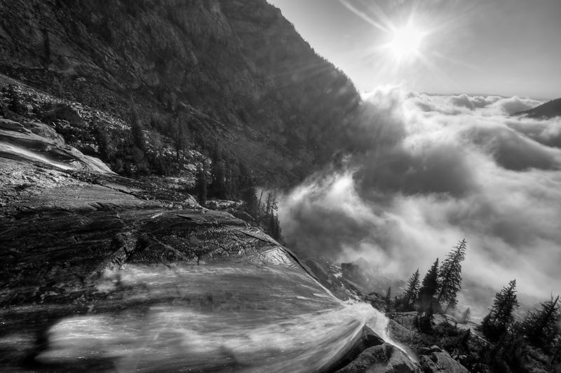 Morning fog lifting from Avalanche Canyon.  Near Lake Taminah, Grand Tetons National Park.  Wyoming