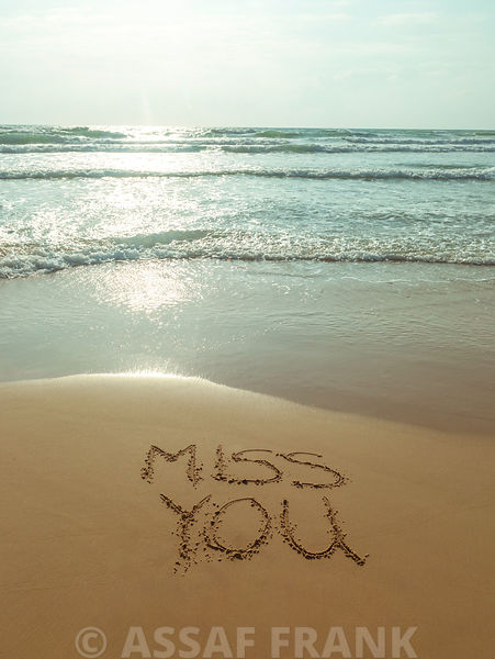 Miss You written on the beach