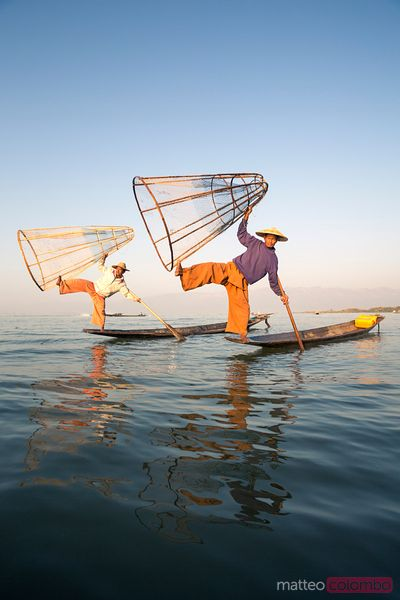 Two local Intha fishermen fishing on Inle lake, Myanmar