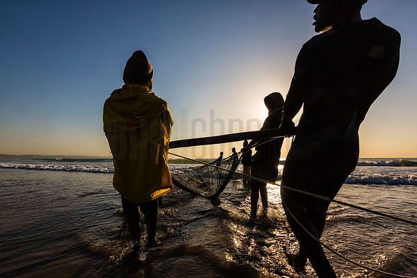 Hauling in the Fishing Net at Sunrise