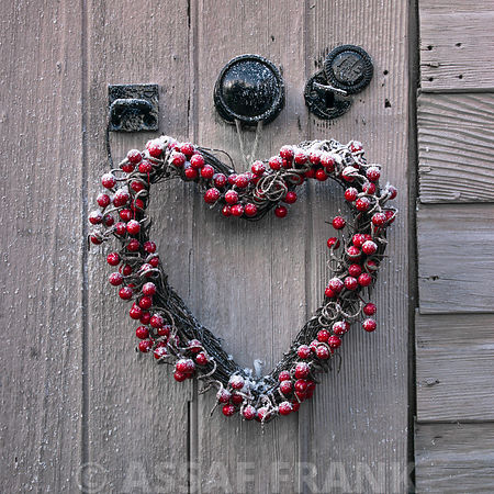 Heart shaped christmas wreath on a door
