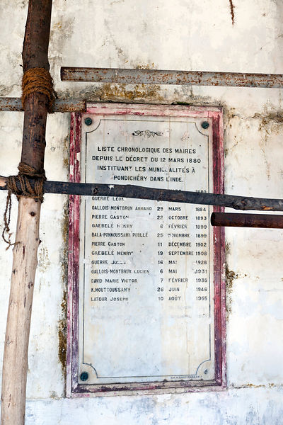A plaque of former French Mayors in the derelict Hotel du Ville that has been saved by INTACH (Indian National Trust for Art ...